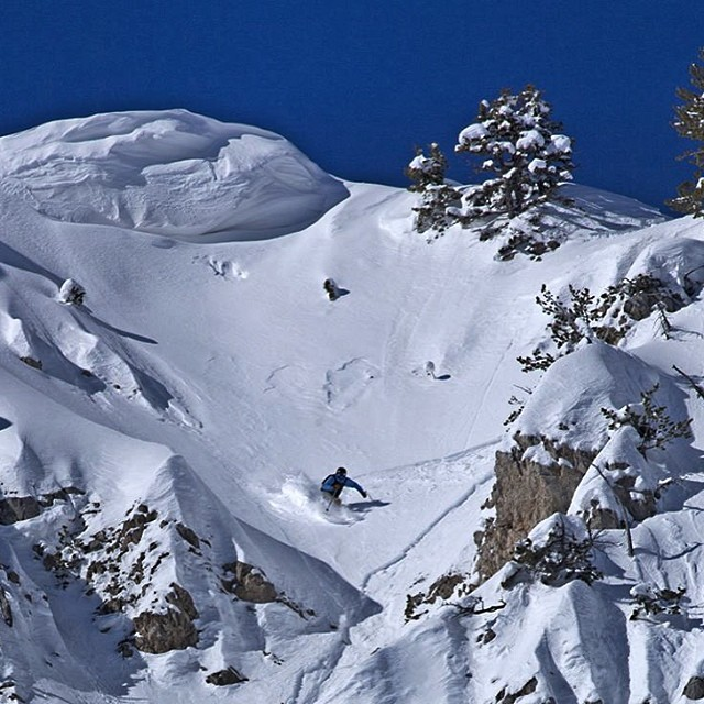 @bridgerbowl ski patrol, Shane Cottom, dropping in off Slushmans Lift. Photo: Pat Clayton