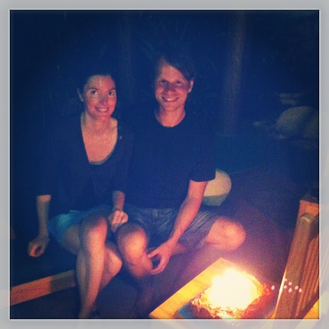 Alex and Julie from Austria enjoy their last night at Bodhi Surf School after a week of surf an yoga. It's also Alex's birthday... He is celebrating with one of the infamous Bodhi chocolate cakes