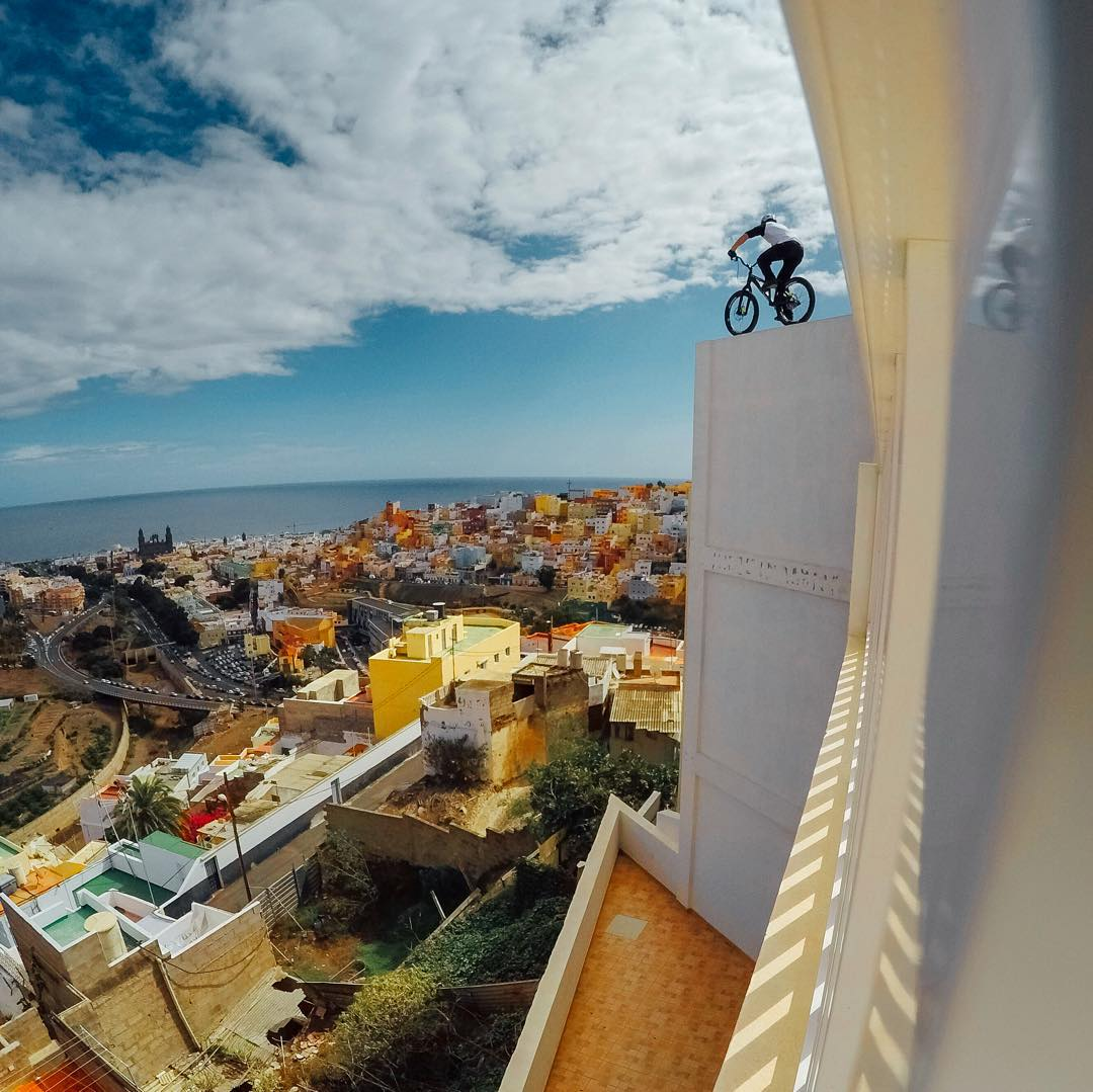 Photo of the Day! @danny_macaskill takes on the colorful rooftops of Gran Canaria while shooting his new edit 'Cascadia.' Hit the link in our bio to watch the #GoPro original production. #Bike