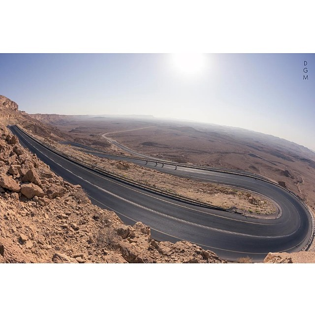 This road. The girls descending Ramon Crater while shooting #lgcopen in the Israeli desert. Go to www.longboardgirlscrew.com to see the new teaser. @mattkienzle photo for #DGM #longboardgirlscrew #roadporn