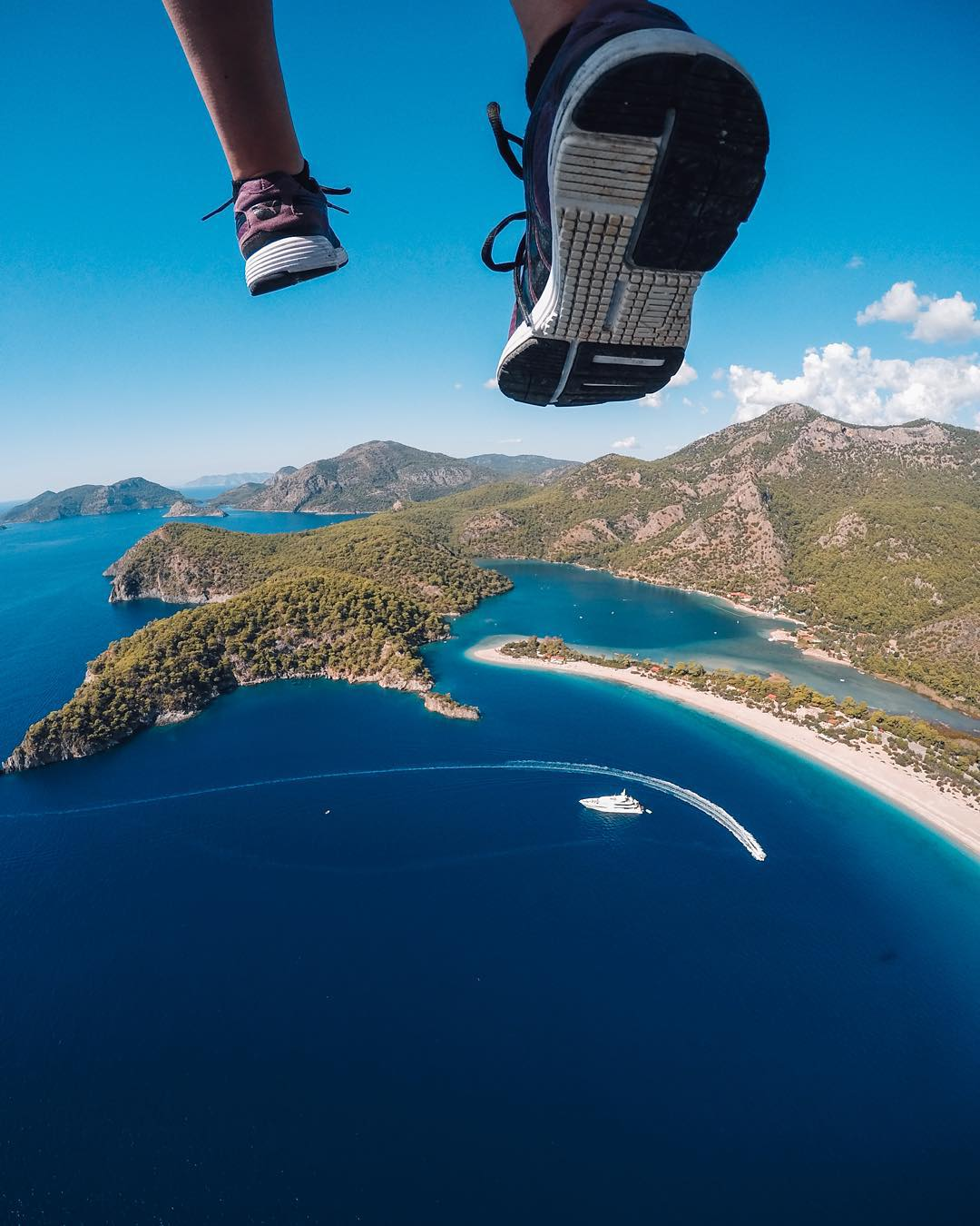 Photo of the Day! @buraktuzer walking on air while #paragliding over #Turkey. Share your most unique perspectives with us by following the link in our bio! #GoPro #Fethiye
