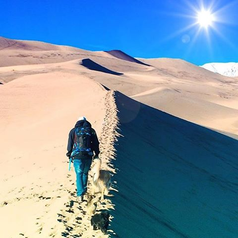 The journey of 1000 miles starts with...selecting the right PACK! We can help. @aporzak1 in perhaps the only photo you'll ever see of him not in snow. #GreatSandDunes #MHMgear #PacksElevated #GetOut #ExploreMore #NationalParks