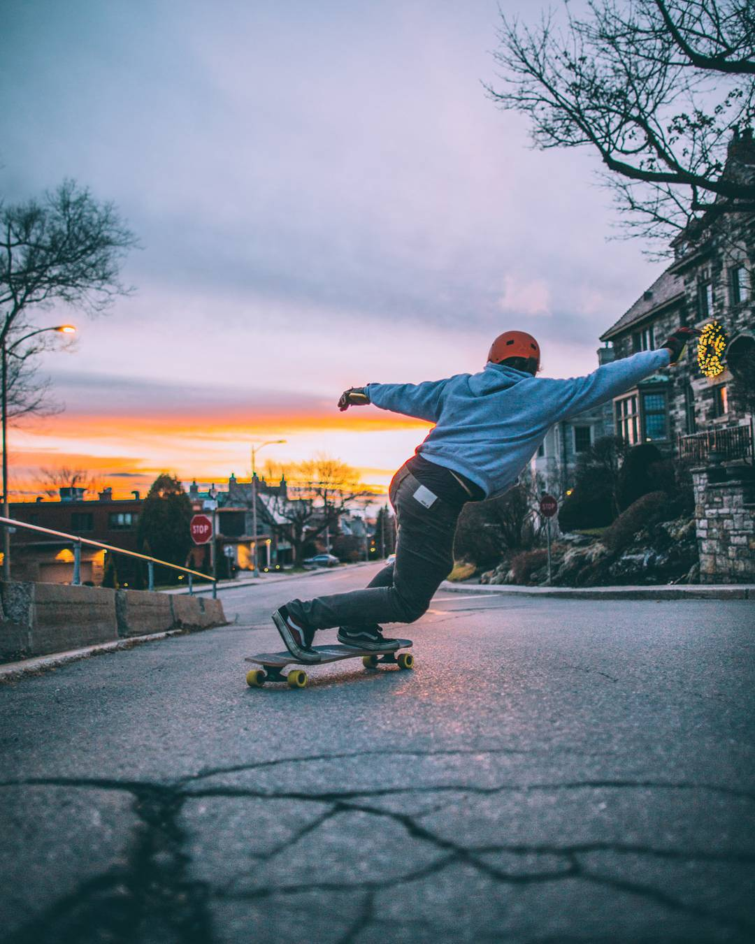 #OrangatangAmbassador @charlesouimet descending into the winter sunset of Montreal.  Photo: @refinedmoment  #Orangatang #yellow #thecage #montreal #sunset