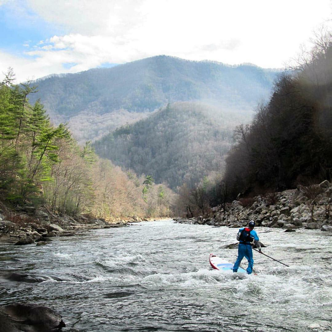 Team rider @jacknife28 paddling the Nolichucky in December! #halagear #halanass #adventuredesigned #whitewaterdesigned #sup #isup #winterpaddling #whitewatersup #coldwatersup #standuppaddle #paddleboard