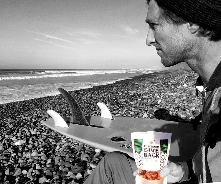 #PHGB athlete @donaldbrink enjoying some of our #trailmix while the waves come in! Read more about his involvement || link in bio!! #snackwithpurpose #jointhemovement @ecowarriorfoundation @innatlb @lbhonpch #beyondsport #travel