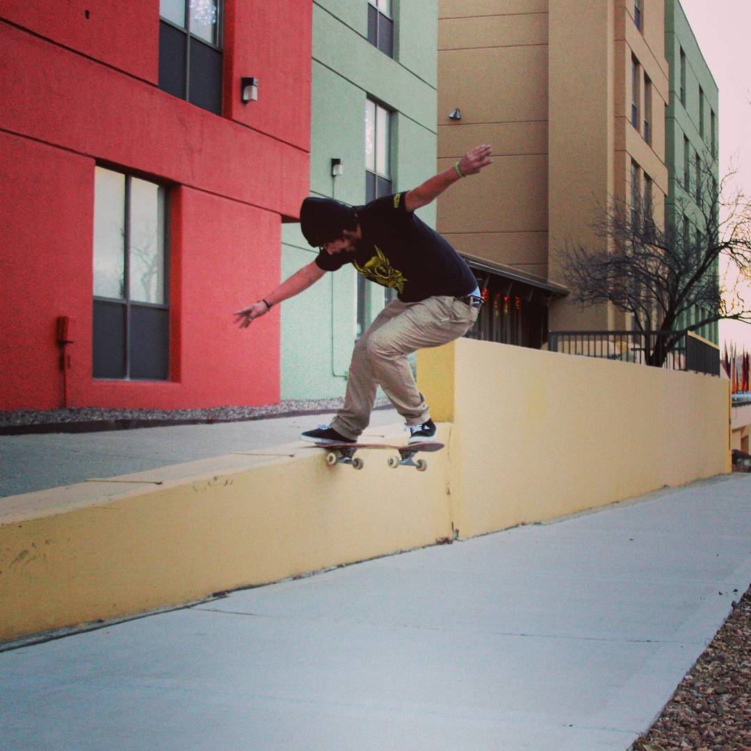 James Tracey--@deadbear13 nose slide between some skate stoppers on the Da Kine!