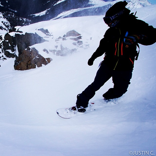 Mallory Hewlko gliding down the ramp of a big couloir in B.C. @malski_ PC @kiousphoto #stellajacket #chariotbib #coolies