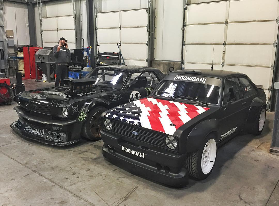 A very rare sight from the #HRD_HQ: my Ford Mustang Hoonicorn RTR alongside the Gymkhana Escort Mk2, with a photobombbird from  @TheHoonigans' Brand Director, @BrianScotto. Both cars have just returned from their 2015 international tours. #hoonvehicles...