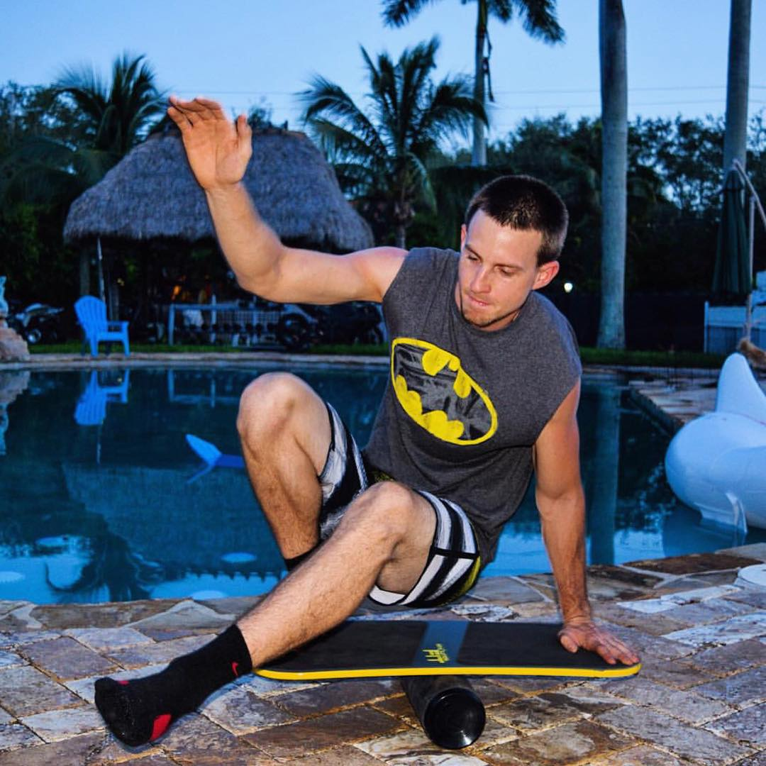 @alanbrownieforlife keeping things fresh out by the pool. #batman #balanceboard