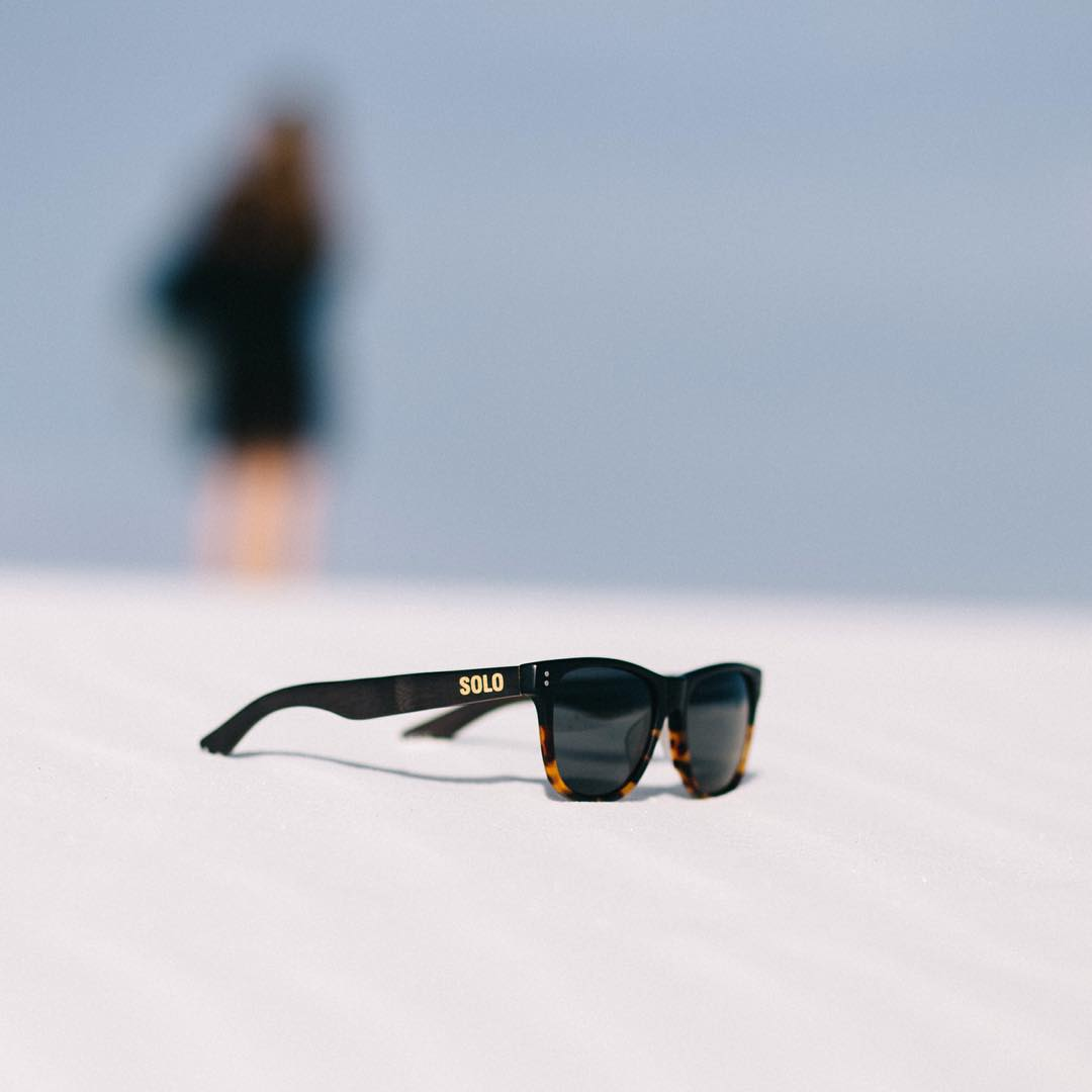 The Thailand frame laying low in the desert sands!  Photo credit: @anthonybaca  #soloeyewear #liveandgive
