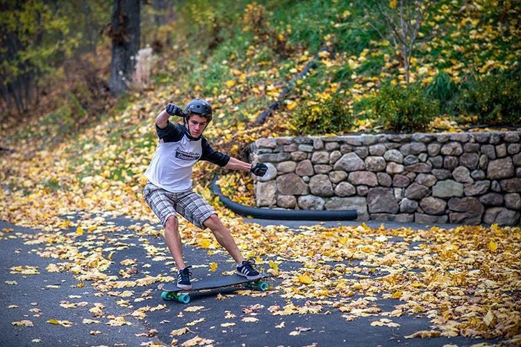 Thomas D'Anieri (@tdanieri) sliding through the leaves on the Robot Special. (Photo by Ryan Hennessee) #dblongboards #robotspecial #longboard #longboarding #skateeverydamnday