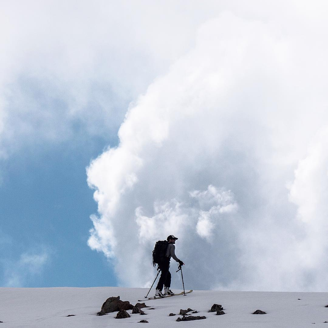 Skiing toward the clouds along the crest of the Tobacco Root Mountains, with Mike Quist Katuz (@mqkautz ) #adventureoftheyear #tobaccoroots #montanamoment #backcountryskiing #adventurescience