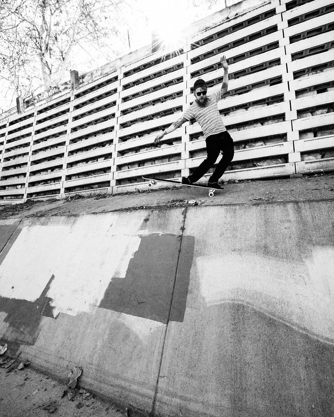 @petermarkgraf with a stylish nose manual above the wall on the LA river. photo @theduster22 #caliber50