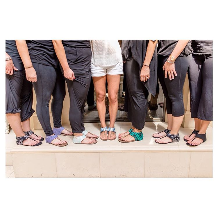 "The more the merrier! ❤️ Love this shot sent by Susana C. of the entire bridal party rocking #Ikhanna sandals. Susana said she'd like to credit @ataleaheadphotography and her husband ""for showing up."""