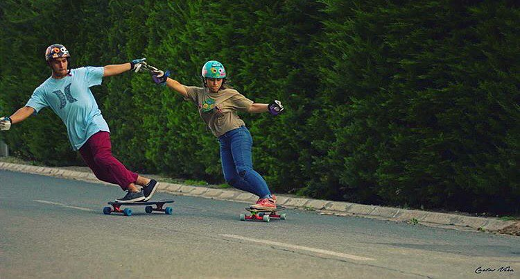 Backsides are better together ❤️ @lgcchileoficial rider @camypm & her man. More mixed runs & photos please!  Carlos Nesa photo.  #longboardgirlscrew #womensupportingwomen #skatelikeagirl #bettertogether #lgcchile #camilapeña #love