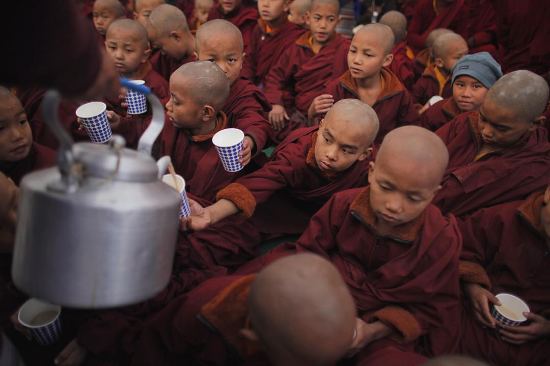 Tea time. During large Tibetan Buddhist prayer festivals, participants and attendees are always offered tea. This was taken during the Monlam Festival for World Peace. Read more in our Journal.