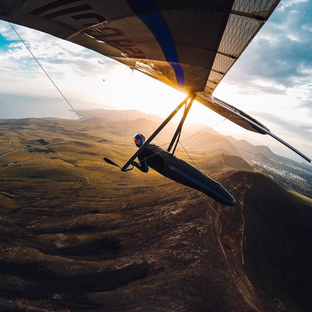 Photo of the Day! Flying into Friday like  @matjazklemencic. Have you got big plans this weekend? Share them with us via #GoProAwards link in our bio! #GoPro #Hangglide #Gliding