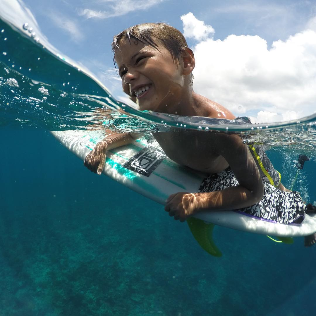 GoPro Featured Photographer and Athlete - @anthony_walsh_  About the Shot: I love this photo of my son Damien playing on my board after a #surf in #Indonesia. He had already been in the water for 2 hours and he is still having the best time ever.  What...