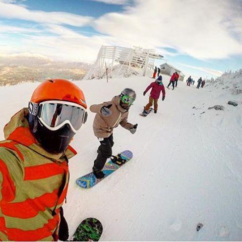 @mollyrae27 and co enjoying some bluebird turns. #sisterhoodofshred #sugarloaf #snowboarding #lineup