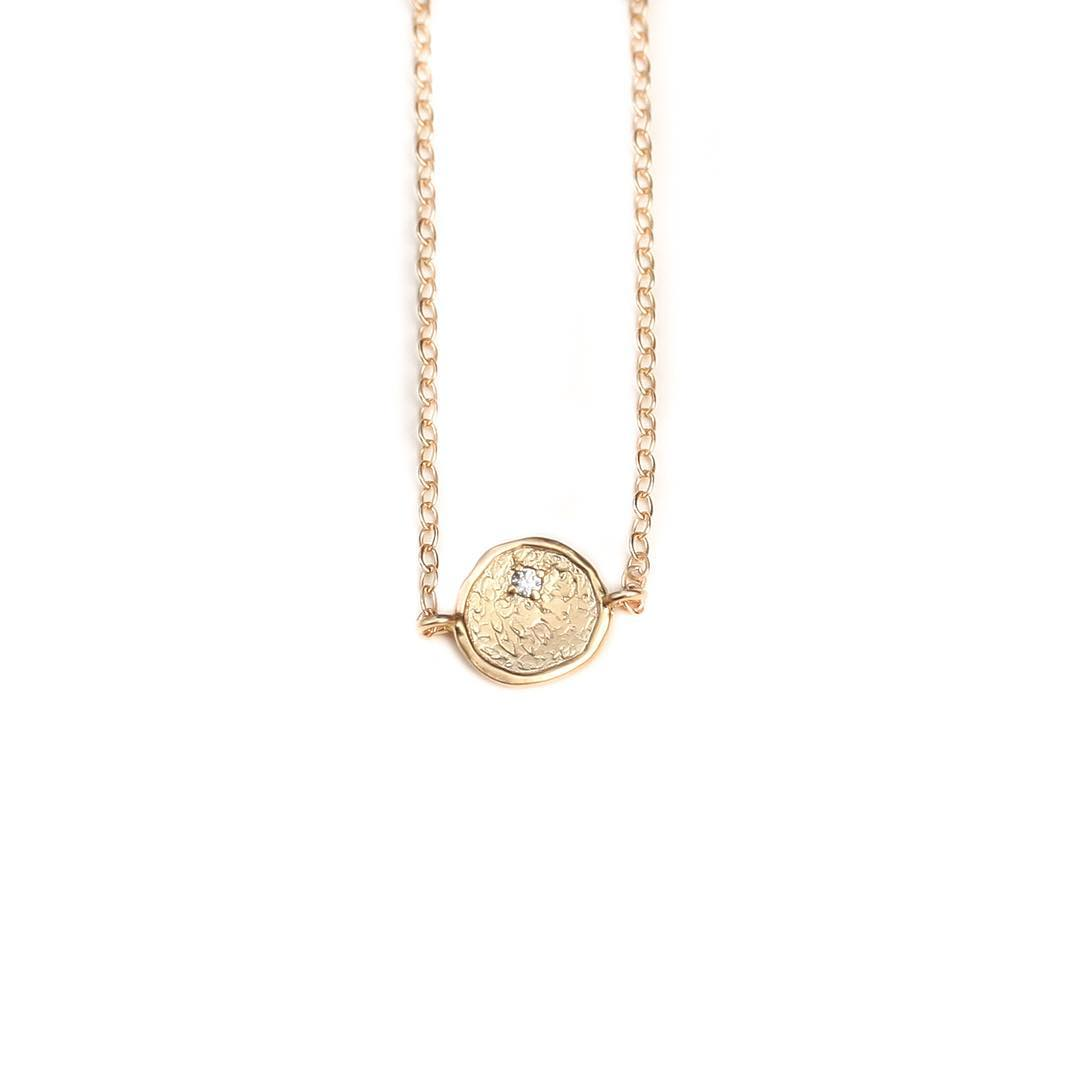 The new limited edition Gold Slice Necklace. Beautiful organic shape with a CZ embedded for a beautiful guided light in your day!  Www.JuliaSzendrei.com  #valentinesday #vday #diamondslice #juliaszendrei #juliaszendreijewelry