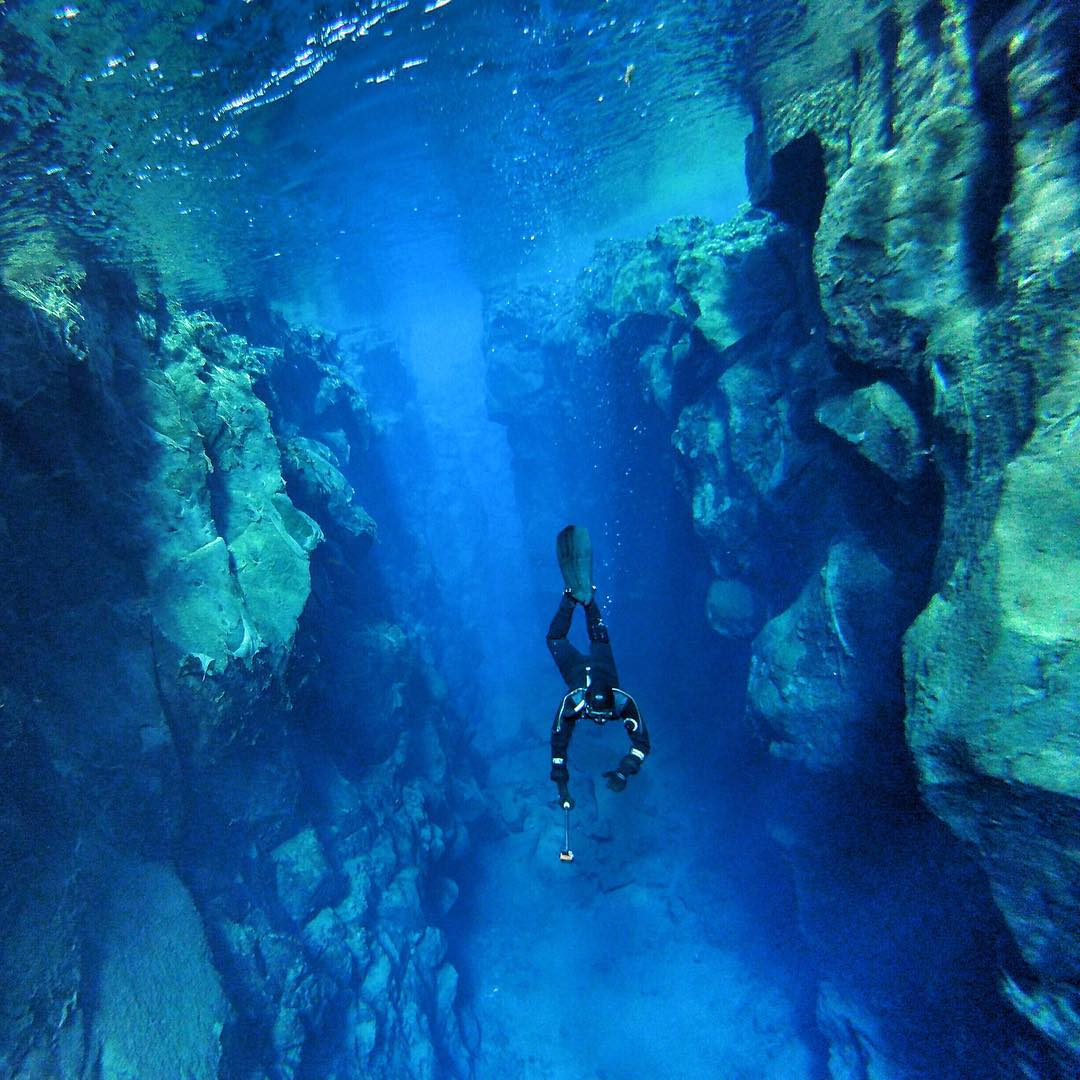 Photo of the Day! The @waterlust crew joined @dive.is to explore the continental divide in #PingvellirNationalPark in #Iceland, where the North American and Eurasian tectonic plates create a fissure. It is some of the clearest water on Earth. Check out...