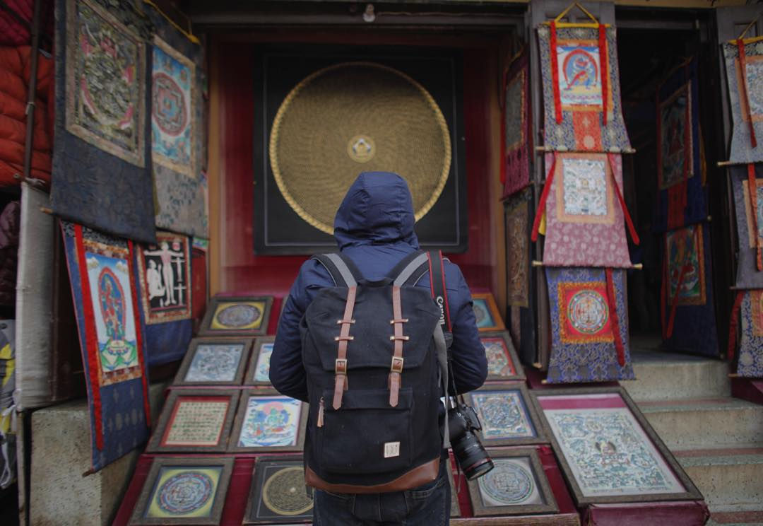 Checking thangkas in Kathmandu. Nepal is home to the most renowned artists of these traditional Tibetan paintings done. Many of which take months to produce.