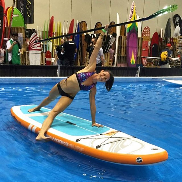 @waveofwellness demoing one of our new bikinis on the SUP Demo pool at Surf Expo! Come by our booth #3138 and check out the new line. ✨