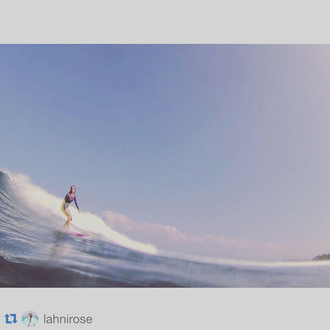@lahnirose sliding through Hawaiian waves in Flawel Print Surfsuit