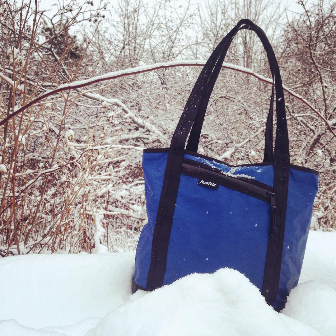 The #Stormproof Porter tote is available through the link in our profile.  Our home state of #Maine has everything to do with our design philosophy. #Flowfold products are built from the toughest and lightest fabrics in the USA with a lifetime...