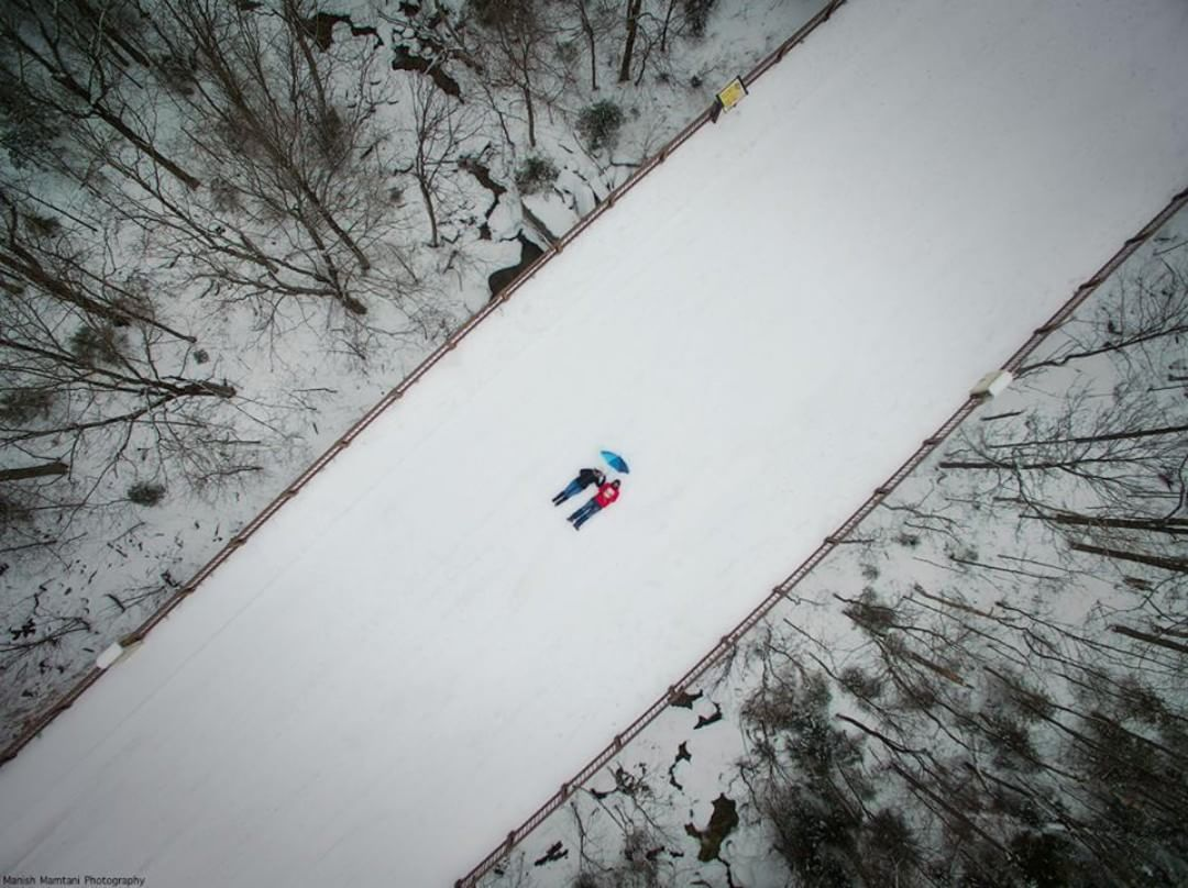 @mmamtani gives us a magical #dronie capturing two figures in the snow, surrounded by the quiet of the forest. Beautiful shots, memorable moments. #IamDJI #WhatsNext