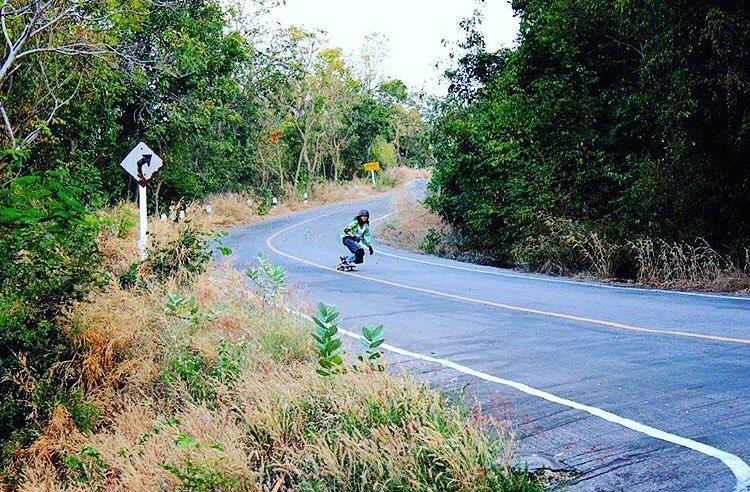 LGC Thailand rider @cheetahzita pumping local hills. Yeah Zita, keep ripping!  @benvasana photo. #longboardgirlscrew #womensupportingwomen #skatelikeagirl #lgcthailand #zitaardhan #thailand #lgc