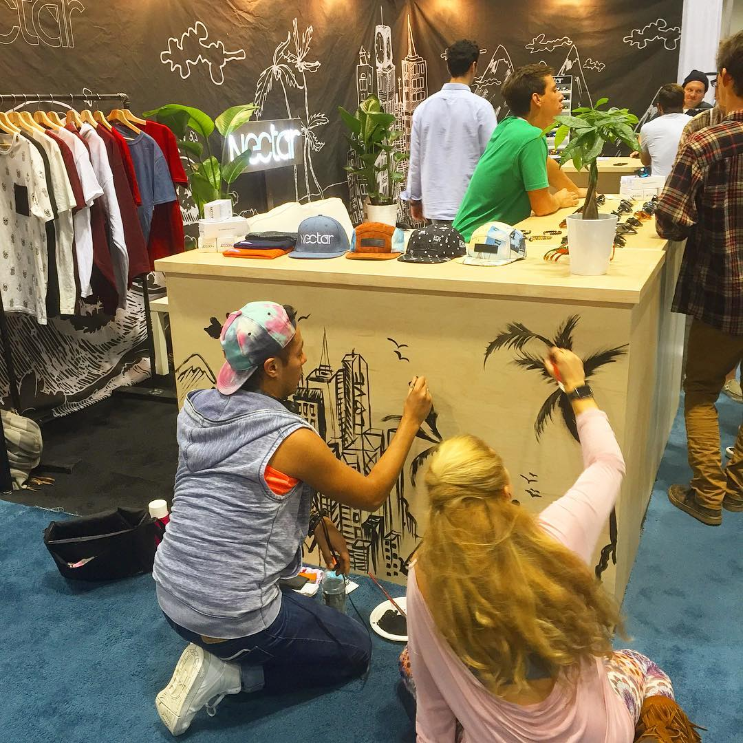 At @surfexpo we had the privilege of having @jessgo333 and Miguel Chavez do a quick piece at our booth. Met them LATE night and they agreed to come paint. Check out her page! Its a great addition to the office! || #liveart #thesweetlife #doepicshit