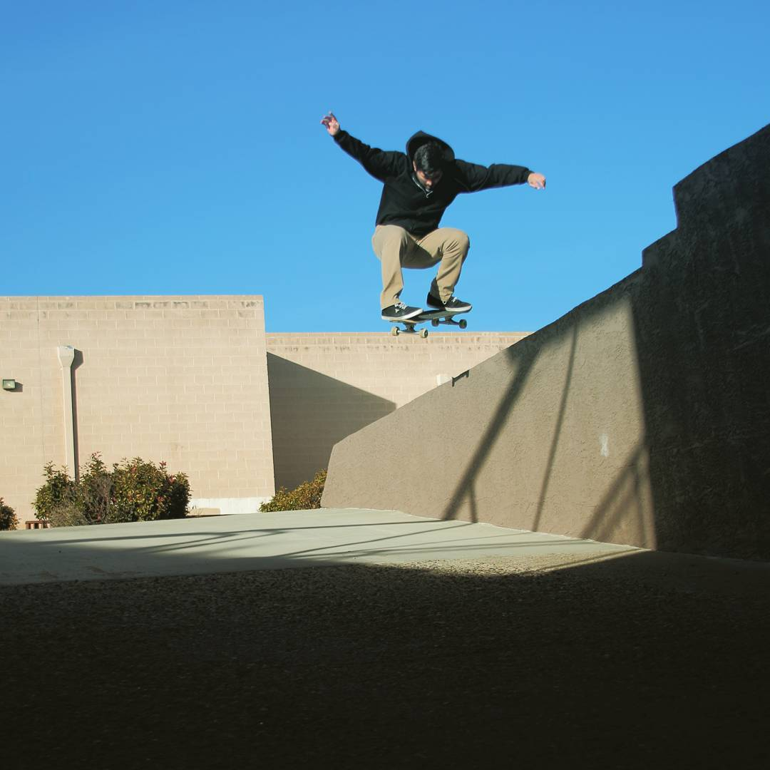 James Tracey--@deadbear13 pops over the wall on the Da Kine!
