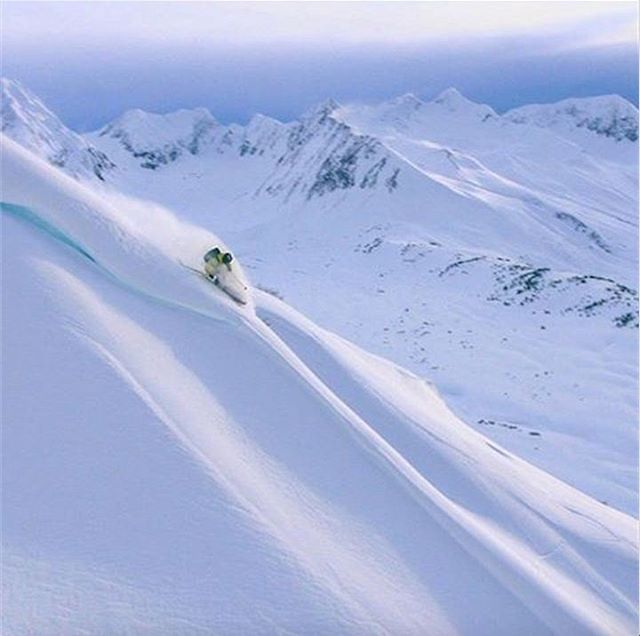 DPS Koala @pierssolomon chasing the perpetual sunset while filming for #DPSCinematic. Photo: @dpizza. #dpsskis #Alaska #powder #skiing