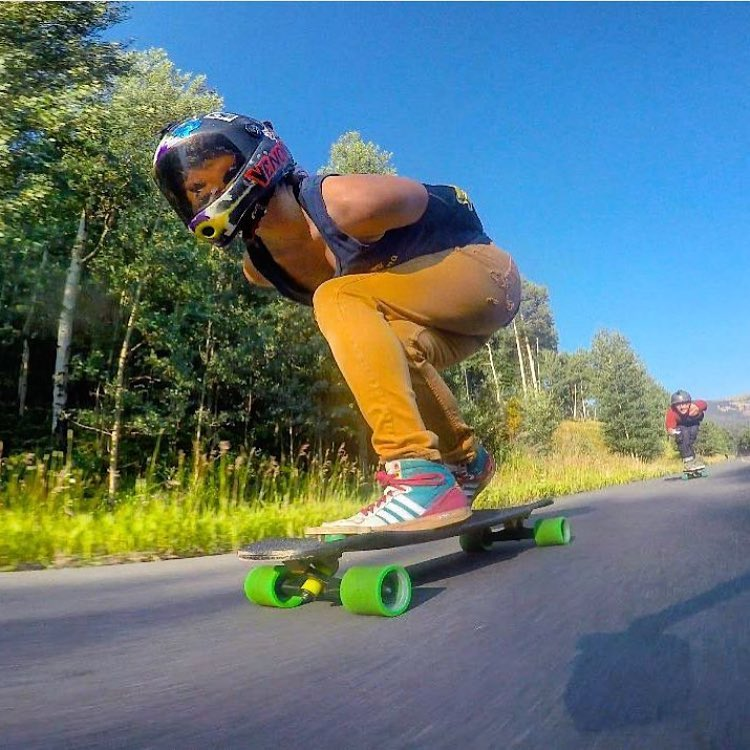 Current #3 on the @idfracing Women World ranking @lorynlongboards on the stoke of downhill skateboarding. @zackronick photo.  #longboardgirlscrew #womensupportingwomen #skatelikeagirl #lorynroberson #downhillskateboarding #girlsgonefast