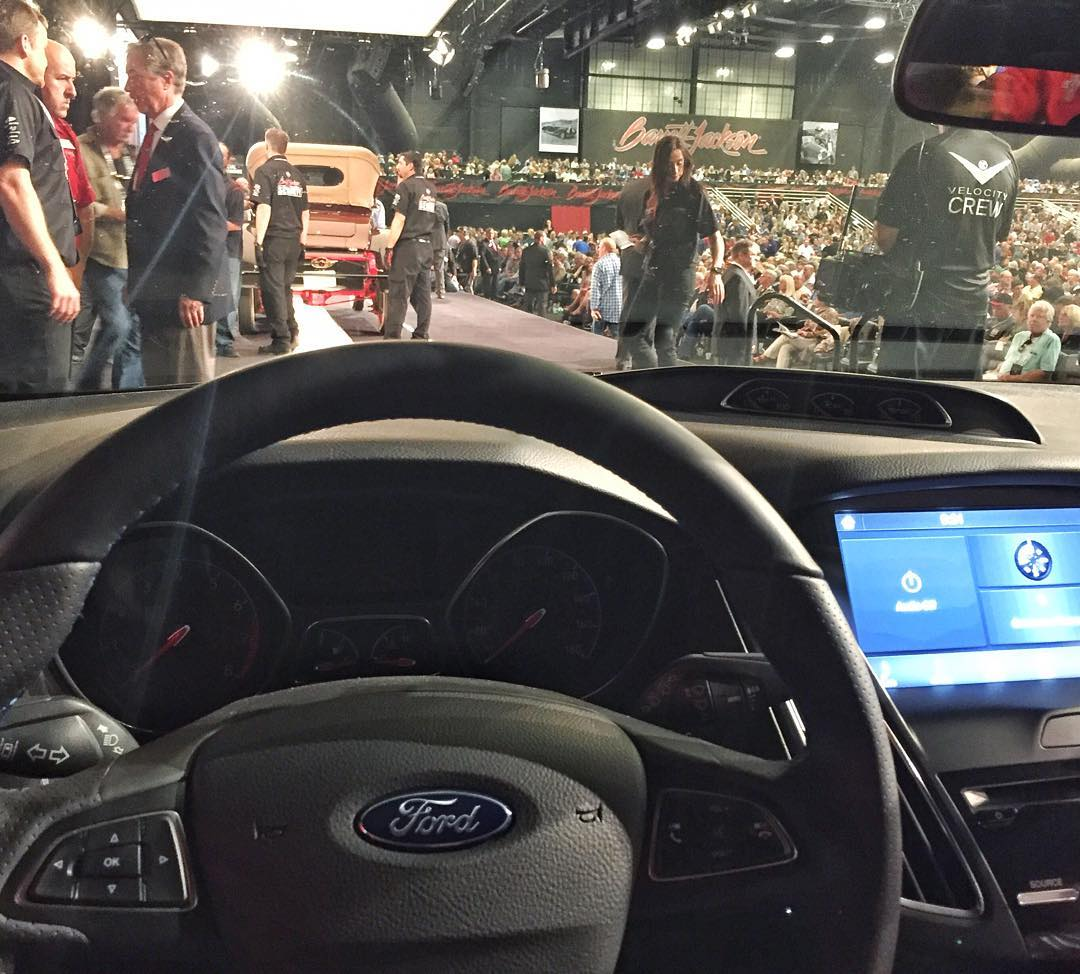 Well this was a first for me when it comes to looking out the windshield of a car: an auction block entrance ramp! A quick behind-the-scenes pic right before I drove a Ford Focus RS (with Ford CEO Mark Fields riding shotgun) up onto the stage at...