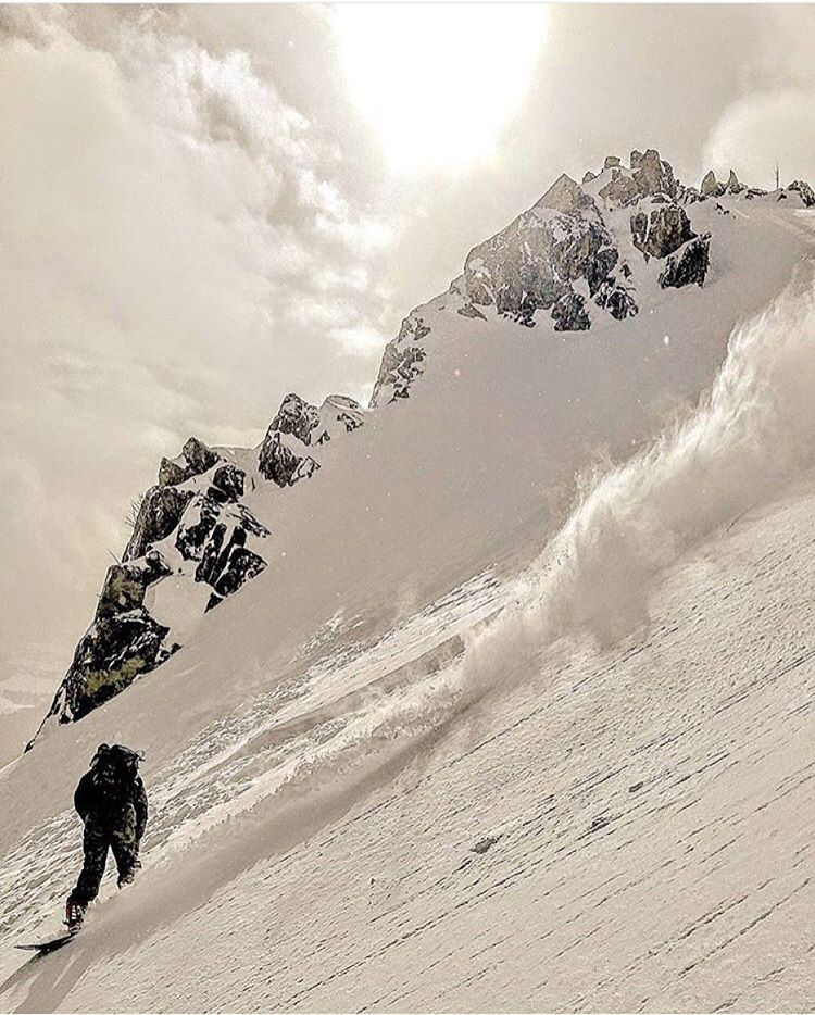 Adventurer @codemagenta_ chases the moment somewhere deep in the mountains. #avalon7 #liveactivated #snowboarding www.avalon7.co
