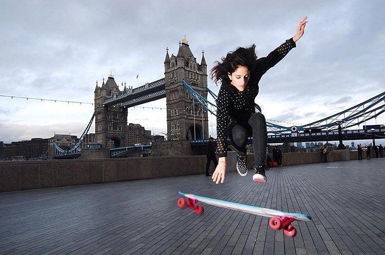 Radness! @longboard_girls_crew_uk Ambassador @ballerignar getting some air in London. @roostersewerrats photo. Repost from @thrillmagazine.  #longboardgirlscrew #womensupportingwomen #skatelikeagirl #lgcuk #crisballerignar  #rad #london #uk