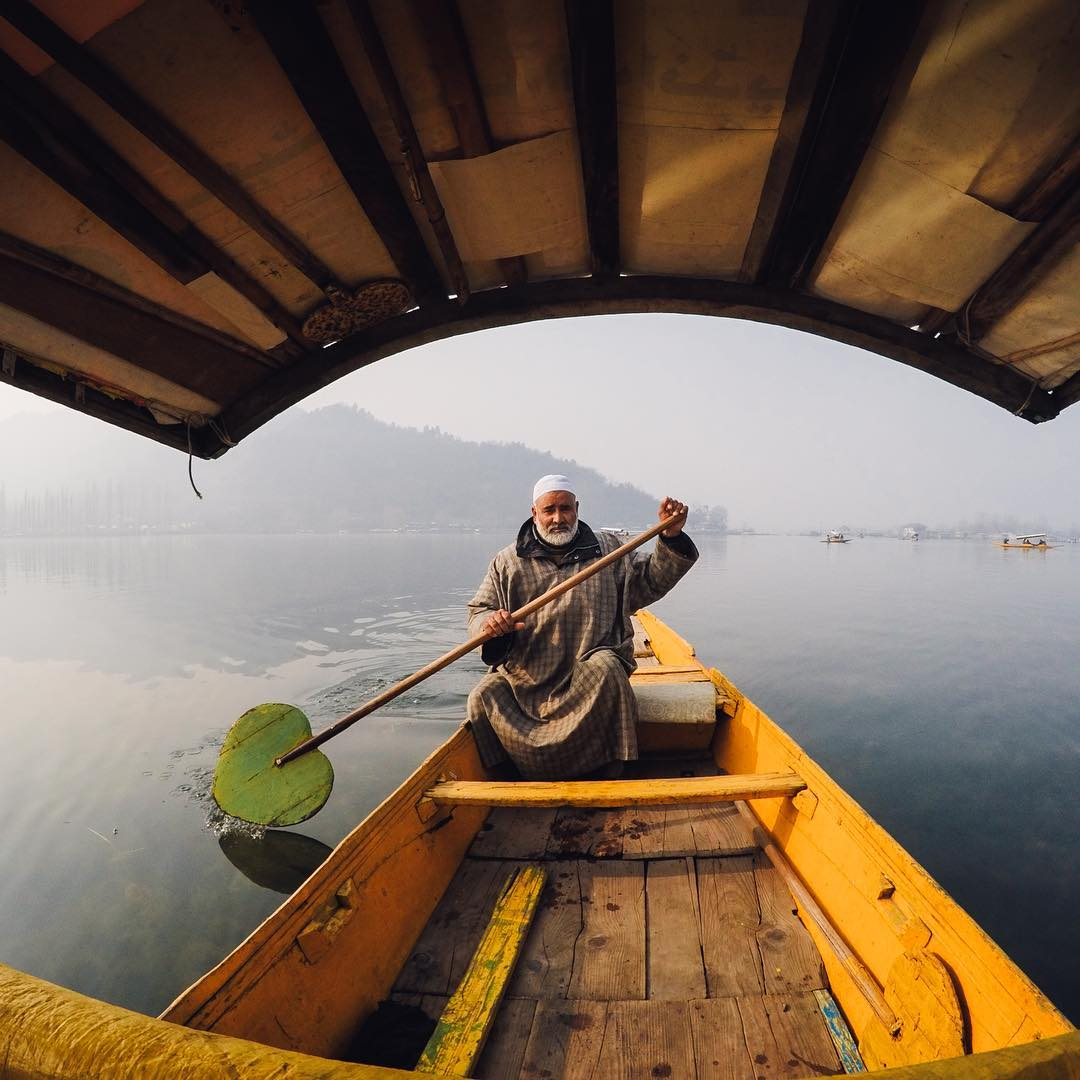 Photo of the Day! A passengers view of Mohammed, who has been rowing #shikaras since childhood on #DalLake in #India. #