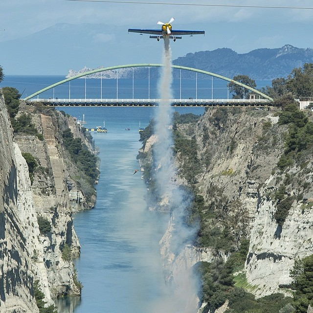 Heads up: Red Bull Air Race's Peter Besenyei flies through the Corinth Canal. #airrace #aerobatics
