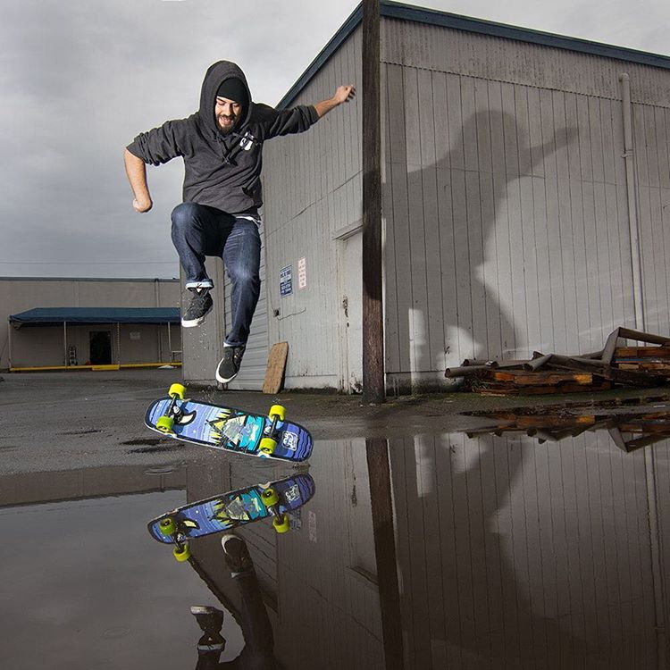 Skate breaks at the shop with our photographer @equalmotion featuring an old school kick flip, the Camp Mini Cruiser and parking lot puddles. #dblongboards #dbmini #skateboard #dbskateboards #igers_seattle #rain #pnwlife #kickflip #reflection