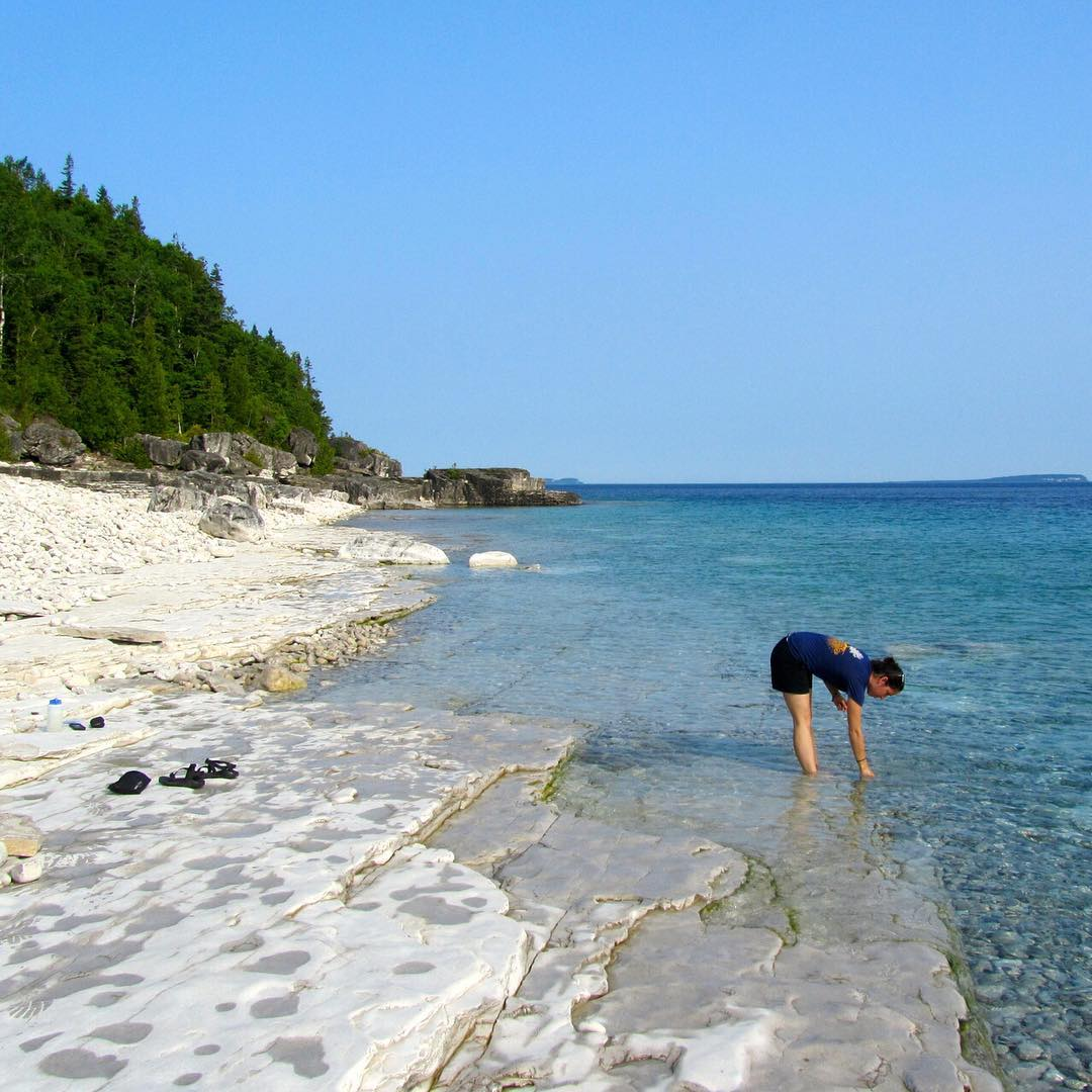 Throwback to last summer, when Kara Steeland added an extra element to her backpacking trip by collecting samples for the Global Microplastics Initiative around the Georgian Bay in northern Ontario.  Photo by Justin Hesselbart #adventurescience...