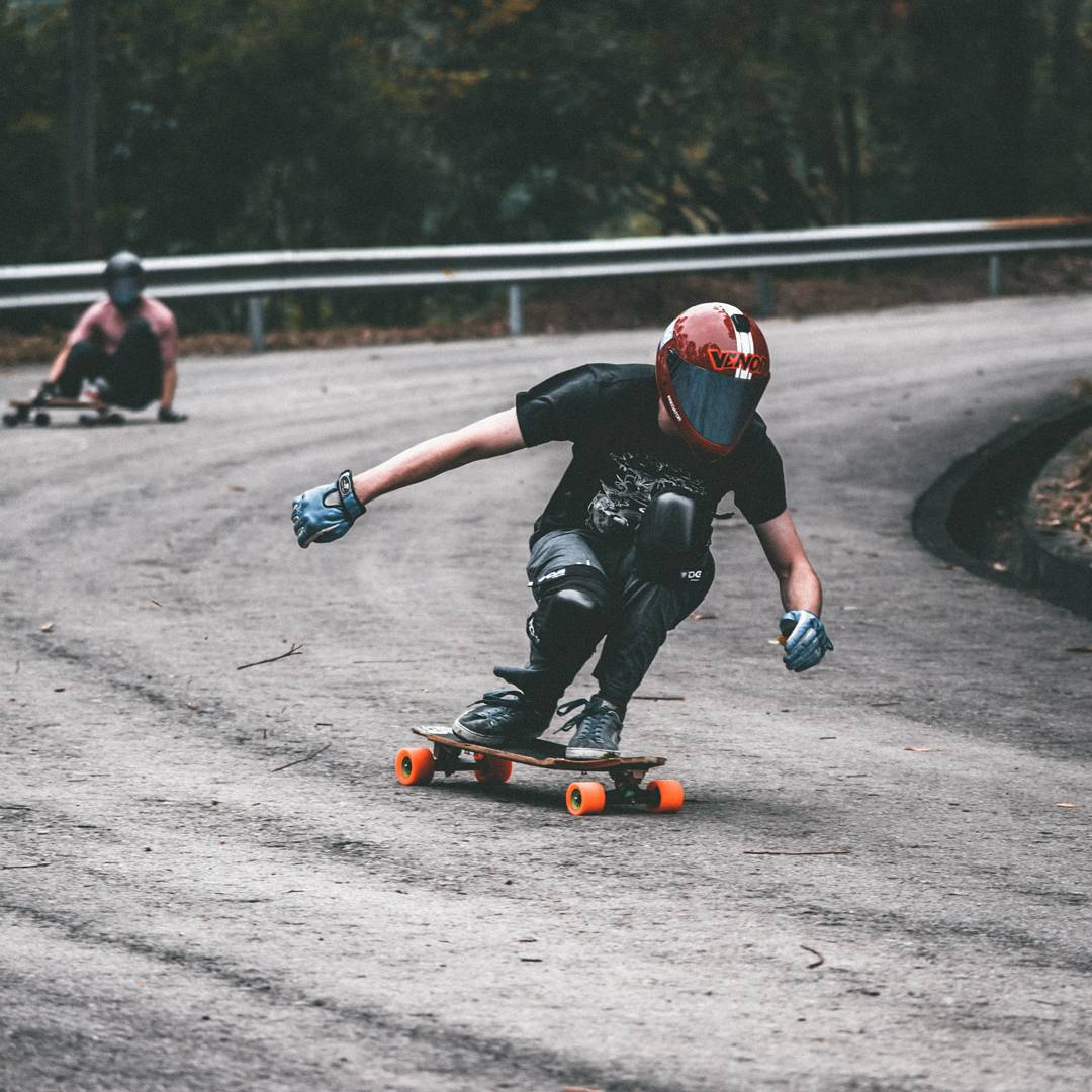 Rain can't stop the trucking power of #OrangatangAmbassador @hazzaclarke_hlss on his Orange Kegels.  His bearings are probably feeling the hurt though... #Orangatang #Orange #Kegels
