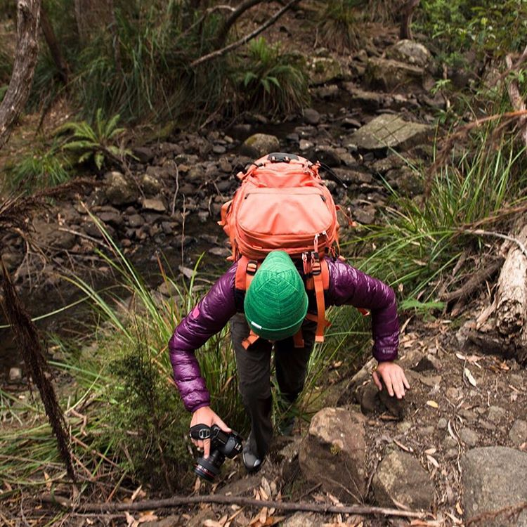 @krystlejwright trekking with a Clutch hand strap in Tasmania.  Photo by @abbylovis. #clutchhandstrap #peakdesign #findyourpeak #tasmania