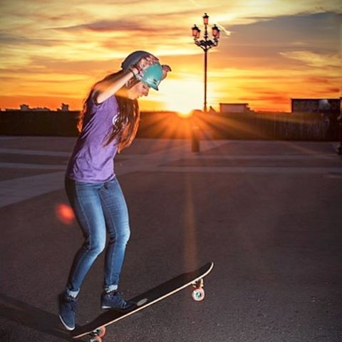 @valeriakechichian taking the sun down in Madrid on the @longboardgirlscrew board