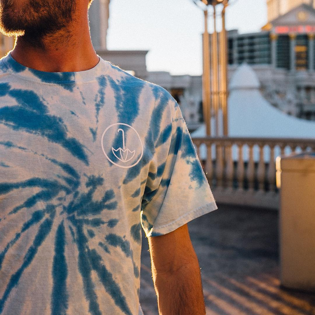 scored this shot of the homie @wilclaussen. whole squad got umbrellas on 'em. who wants a tie-dye tee?