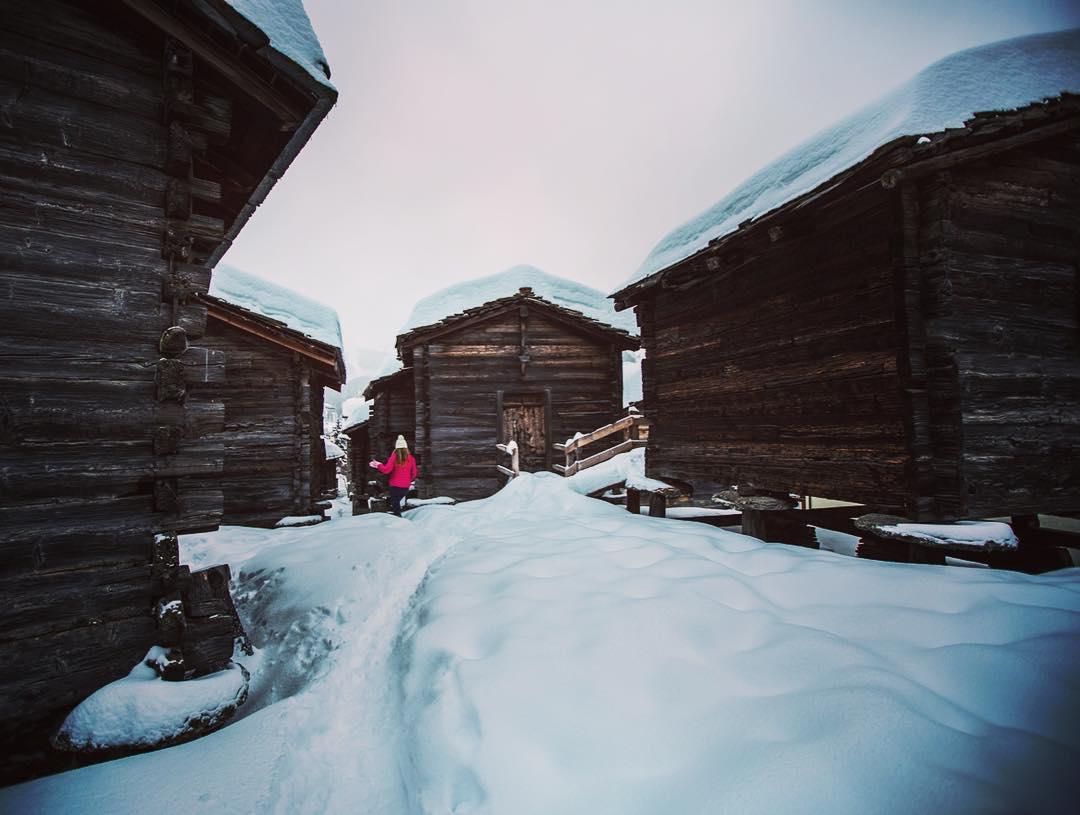 There's plenty of snow in Saas Fee! ❄️ @alisonsadventures wandering between the old granaries in town.  @saasfee_saastal @myswitzerland @valaiswallis #inLOVEwithSWITZERLAND #mywinterinvalais