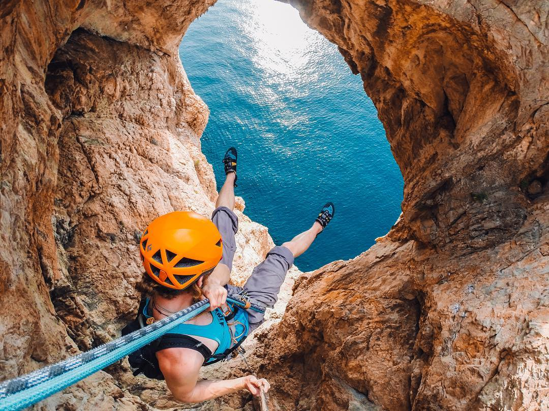 Photo of the Day! Staring into an opening 50m above the ocean, @kieranjduncan preps to #abseil down. Getting into some gnarly situations? Share with us at gopro.com/awards. #GoPro #Climbing