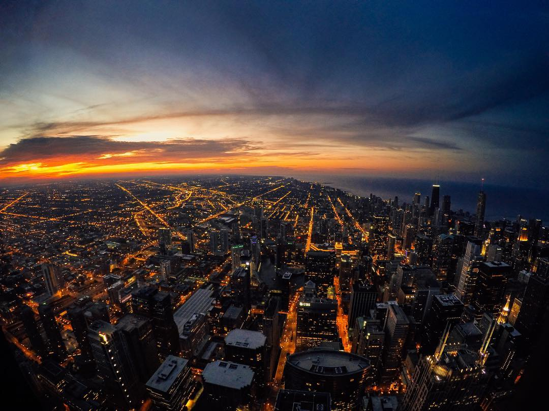 Photo of the Day! Chicago, you're looking real good. (Just don't look down!) @tmahlmann caught this #sunset from the 103rd floor of the Willis Tower. Share your beautiful views with us via #GoProAwards link in our bio. #GoPro