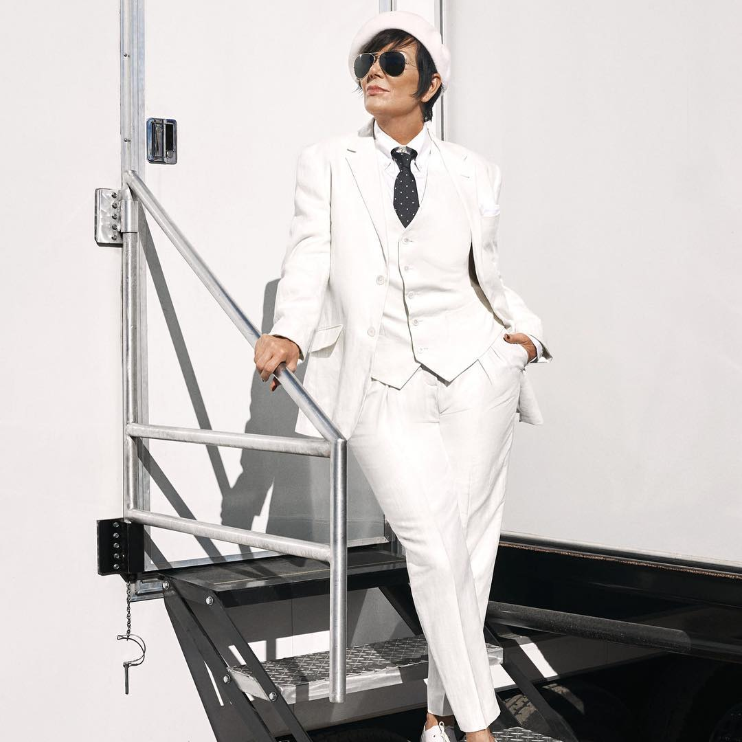 @krisjenner discusses all things Kardashian in the March issue of @harpersbazaarus. Take a look at her all-white look, capped off with #kangol.